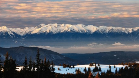 Pirin National Park and World Heritage site in Bulgaria as seen from neighbouring Rila National Park. Bansko ski zone pistes may be seen to the very left.